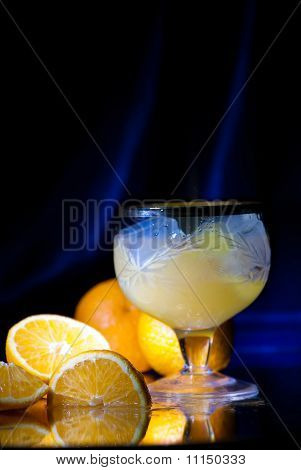 Drink In A Glass With Ice And Juicy Tangerines