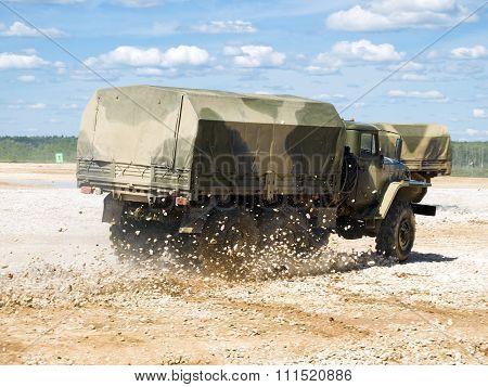 Military truck Ural 4320 makes skid