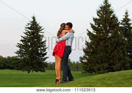 Guy and the girl tenderly embrace.