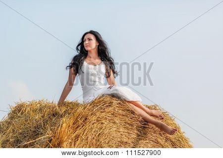 Brunette Woman On Hay Bale