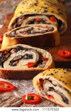 Stromboli With Mushrooms And Pepper Close-up. Vertical