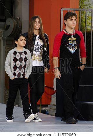 Los Angeles - January 26, 2012. Prince Michael, Blanket and Paris Jackson at the Michael Jackson Hand And Footprint Ceremony held at the Grauman's Chinese Theatre, Los Angeles.