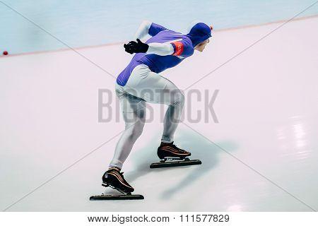 closeup man athlete speedskater on track sprint race