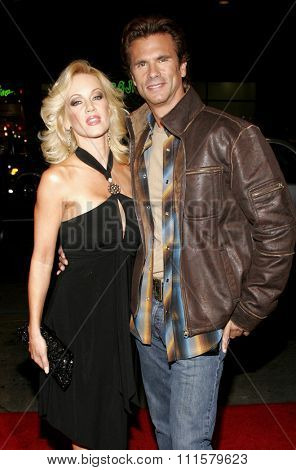 HOLLYWOOD, CA - FEBRUARY 02, 2006: Barbara Moore and Lorenzo Lamas at the World premiere of 'Firewall' held at the Grauman's Chinese Theatre in Hollywood, USA on February 2, 2006.
