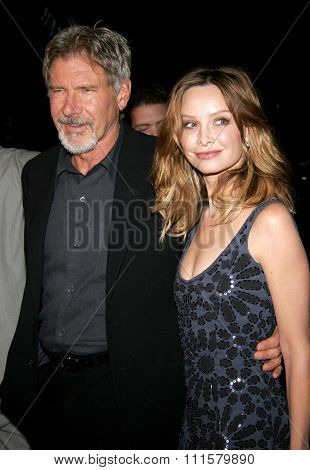 HOLLYWOOD, CA - FEBRUARY 02, 2006: Calista Flockhart and Harrison Ford at the World premiere of 'Firewall' held at the Grauman's Chinese Theatre in Hollywood, USA on February 2, 2006.