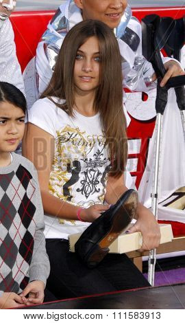 HOLLYWOOD, CA - JANUARY 26, 2012: Blanket Jackson, and Paris Jackson at the Michael Jackson Immortalized held at the Grauman's Chinese Theatre in Los Angeles.