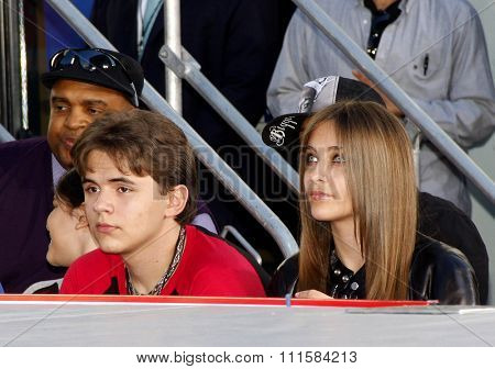 HOLLYWOOD, CA - JANUARY 26, 2012: Prince Michael, Blanket Jackson and Paris Jackson at the Michael Jackson Immortalized held at the Grauman's Chinese Theatre in Los Angeles.