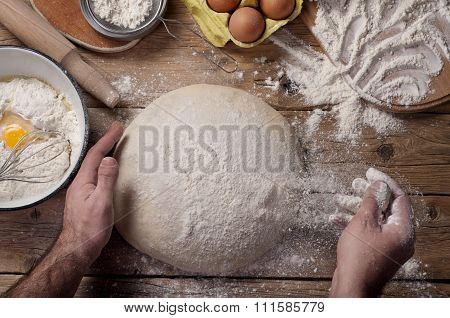 Male Baker Prepares Bread