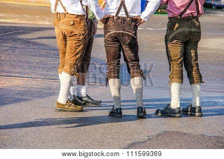 Four men wearing lederhosen at Octoberfest in Munich, Germany
