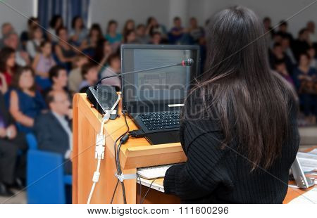 Business Woman During A Slide Show