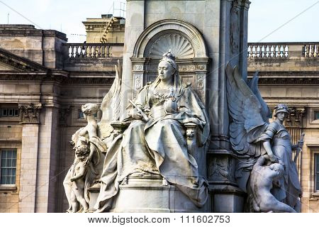 Imperial Memorial to Queen Victoria (1911 designed by Sir Aston Webb) in front of Buckingham Palace was built in honor of Queen Victoria who reigned for almost 64 years. London UK. poster