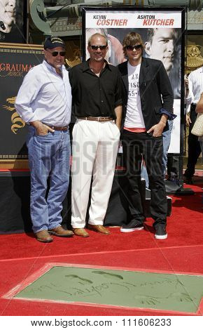 09/06/2006 - Hollywood - Kevin Costner, Andrew Davis and Ashton Kutcher at the Kevin Costner Hand and Footprints Ceremony held at the Grauman's Chinese Theater in Hollywood, California, USA..