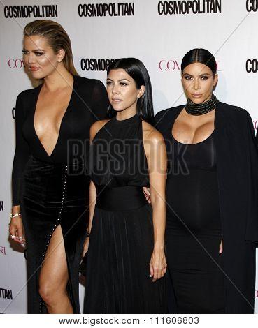 Khloe Kardashian, Kourtney Kardashian and Kim Kardashian at the Cosmopolitan's 50th Birthday Celebration held at the Ysabel in West Hollywood, USA on October 12, 2015.