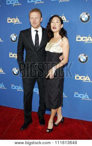 Kevin McKidd and Sandra Oh at the 66th Annual Directors Guild Of America Awards held at the Hyatt Regency Century Plaza in Los Angeles, USA on January 25, 2014.