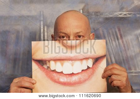 Bald Man Holding A Card With A Big Smile On It