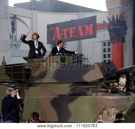 Sharlto Copley and Bradley Cooper arrive on A-Team Tank at the World premiere of 'The A-Team' held at the Grauman's Chinese Theater in Hollywood, USA on June 3, 2010.