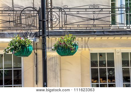 Two Baskets Of Flowers On A Lamp Post In The Center Of London