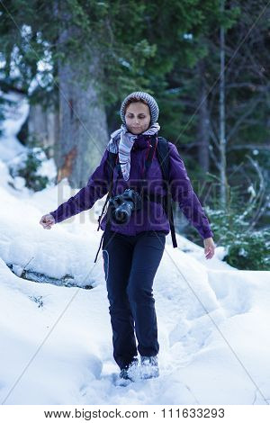 Tourist Woman With Camera In The Snowy Forest