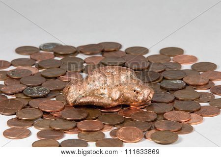 Copper Nugget On A Bed Of Pennies