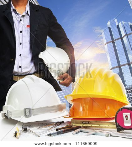 Engineer Working Table Against Sky Scrapper In Urban Scene Use For Land Development And Architecture