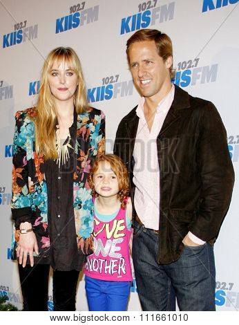 Dakota Johnson and Nat Faxon at the KIIS FM's 2012 Jingle Ball held at the Nokia Theatre L.A. Live in Los Angeles, USA on December 3, 2012.