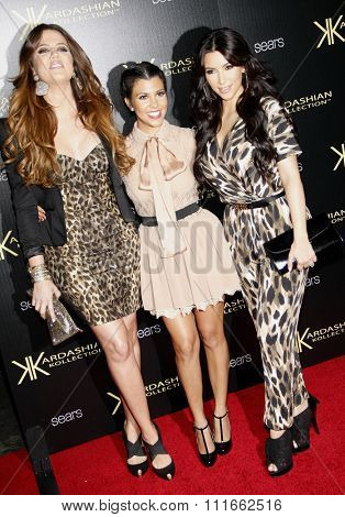 Khloe Kardashian, Kourtney Kardashian and Kim Kardashian at the Kardashian Kollection Launch Party held at the Colony in Los Angeles, California, United States on August 17, 2011.