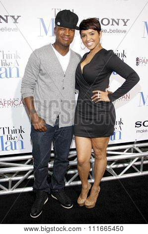 HOLLYWOOD, CALIFORNIA - February 9, 2012. Ne-Yo and Tennille Jimenez at the Los Angeles premiere of