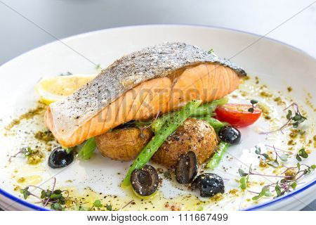 grilled salmon steak with pesto sauce