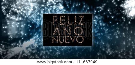 Glittering feliz ano nuevo against colourful fireworks exploding on black background