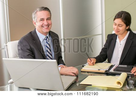 Mature happy business man with business woman