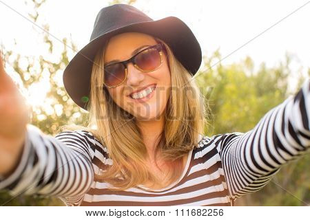 Young trendy hipster woman taking a selfie