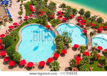 ABU DHABI, UAE - MARCH 25, 2014: Pool area of resort Khalidiya Palace by Rotana in Abu Dhabi, UAE. Rotana Hotel Management Corporation has 85 properties in 26 cities around Middle East and Africa.