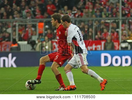 MUNICH, GERMANY - DECEMBER 12 2015: Thomas Muller of Bayern Munich during the Bundesliga match between Bayern Muenchen and FC Ingolstadt, on December 12, 2015 in Munich, Germany.