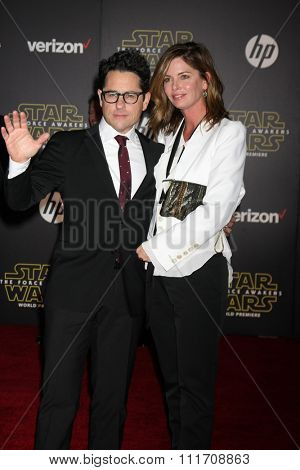 LOS ANGELES - DEC 14:  JJ Abrams, Katie McGrath at the Star Wars: The Force Awakens World Premiere at the Hollywood & Highland on December 14, 2015 in Los Angeles, CA