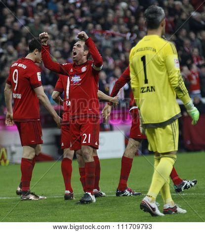 MUNICH, GERMANY - DECEMBER 12 2015: Philipp Lahm of Bayern Munich celebrates scoring during the Bundesliga match between Bayern Muenchen and FC Ingolstadt, on December 12, 2015 in Munich, Germany.