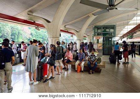 SINGAPORE - NOVEMBER 07, 2015: passengers at MRT station. The Mass Rapid Transit, or MRT, is a rapid transit system forming the major component of the railway system in Singapore
