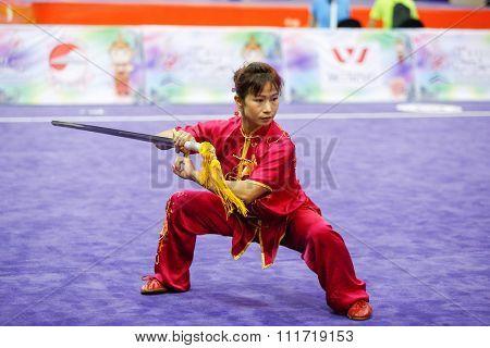 JAKARTA, INDONESIA - NOVEMBER 17, 2015: Sapna Yulembam of India performs the movements in the women's Jianshu event at the 13th World Wushu Championship 2015 in Istora Senayan Stadium.