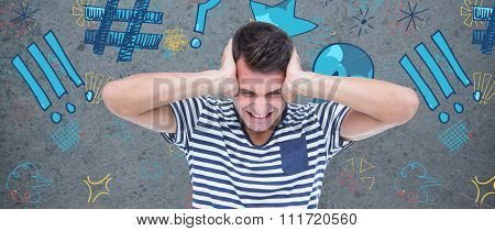 Frustrated man covering ears against dirty old wall background