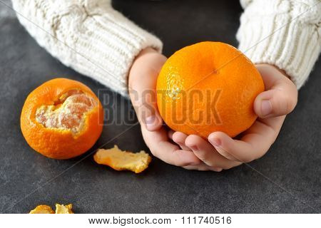 In the hands of the child's Mandarin