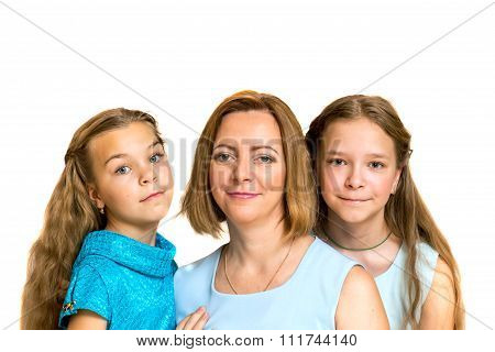 Mother And Her Two Daughters. Family Portrait.