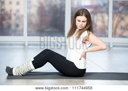 Woman Feeling Pain In Back During Sport Exercise