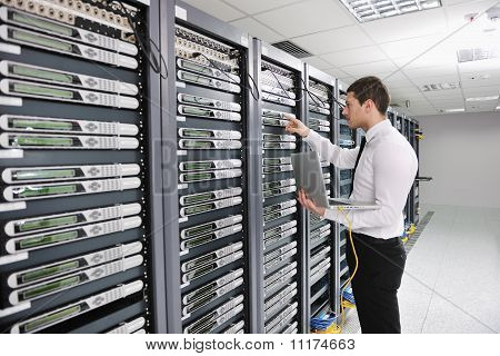 young handsome business man engeneer in datacenter server room poster