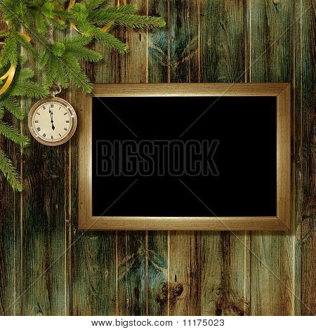 Card For The Holiday With Branches And Clock On The Wooden Background
