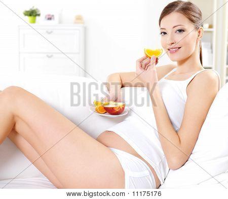 Pregnant Woman Eating Fresh Fruits