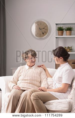 Carer Supporting Elderly Woman