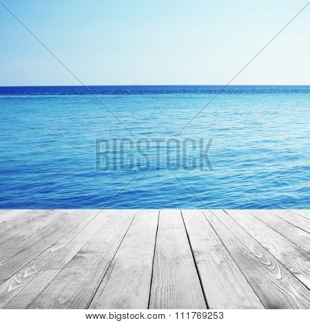 Wooden pier with beautiful sea or ocean  background
