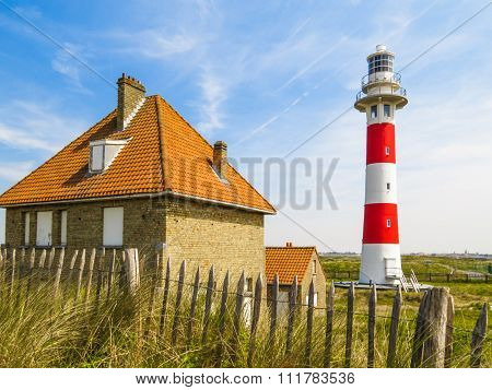 Lighthouse in sandy dunes of the North Sea