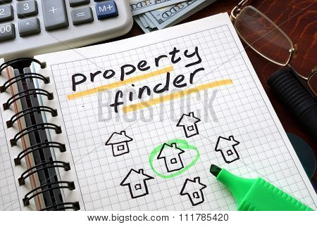 Notebook with  property finder sign on a table.