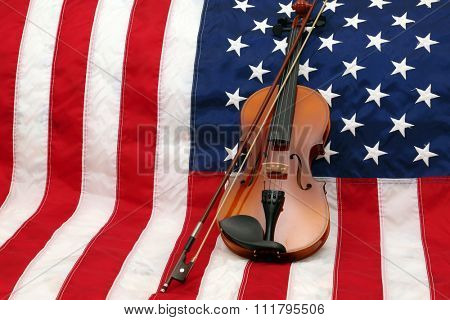 A 3/4 size Violin lays against an American Flag