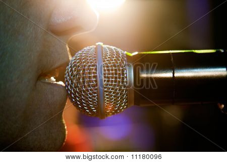 close up singer and microphone